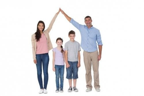 Happy parents joining hands above children