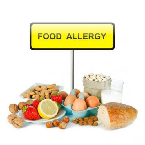 Allergy food concept - bread, milk, fruits, nuts, eggs and beans on white background
