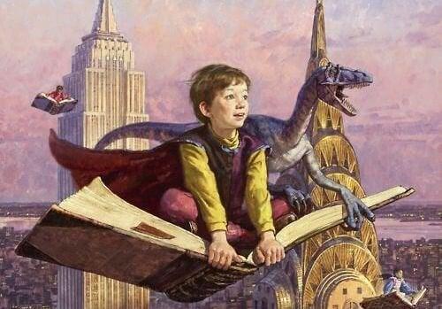niño volando con libro