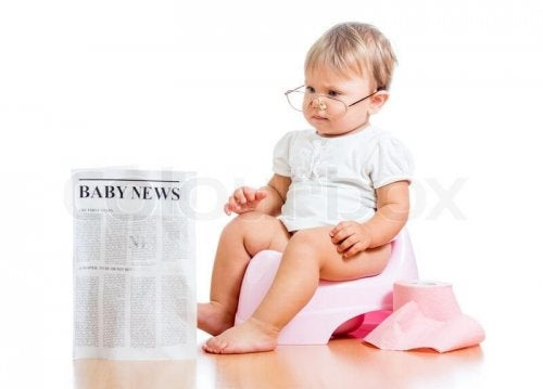 5125311-funny-child-girl-reading-newspaper-on-chamberpot