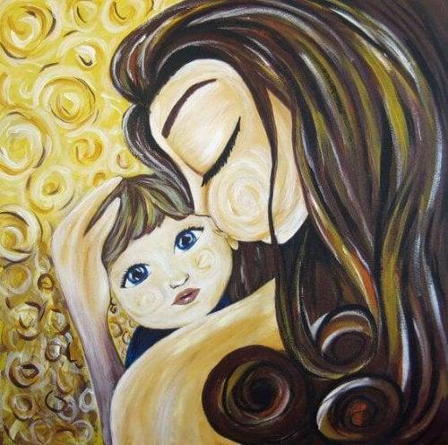 Une maman embrasse son enfant, une façon de montrer à votre enfant que vous l'aimez