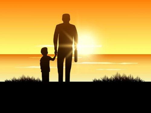 Un petit garçon avec son papa dans la nature