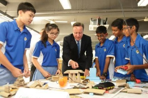 SINGAPORE - JULY 29: British Prime Minister, David Cameron (3rd L) engages with students during a Design & Technology lesson for a class of Lower Secondary School at the Commonwealth Secondary School on July 29, 2015 in Singapore. Prime Minister, David Cameron is on a two day official visit to Singapore, the second of his four nation tour of South-East Asia, to secure trade deals and foster political alliance to counter the Islamic State group. (Photo by Suhaimi Abdullah/Getty Images)