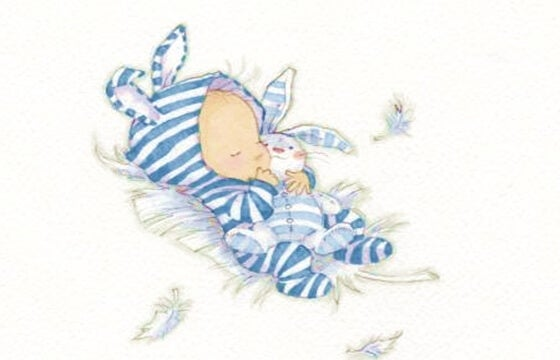 bebé con ropa de conejo