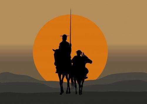 El Quijote y Sancho Panza caminando al atardecer.