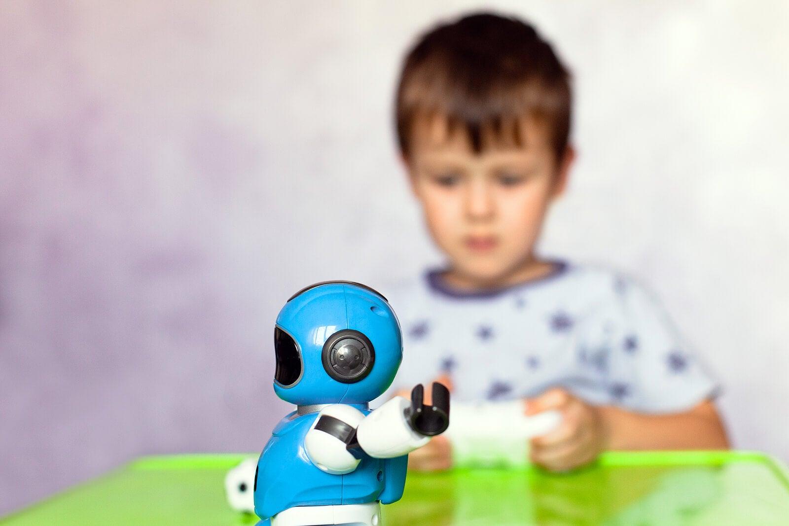 Niño jugando con un robot con inteligencia artificial.